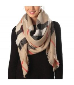 The perfect winter accessory to throw on before you leave home is the blanket wrap scarf.