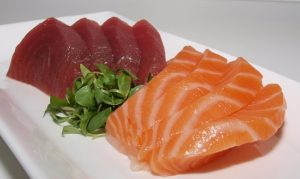 Salmon and tuna are two specific types of meat considered to be rich in Iron.
