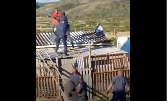 Watch| Man Fights Police Officers On Top Of House Roof-SurgeZirc SA