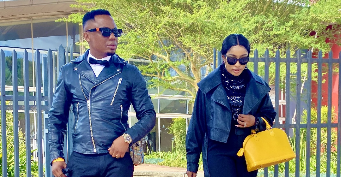 DJ Tira's Wife Dragged For Wearing Pants And Taking Pics At Nellie Tembe's Funeral-SurgeZirc SA